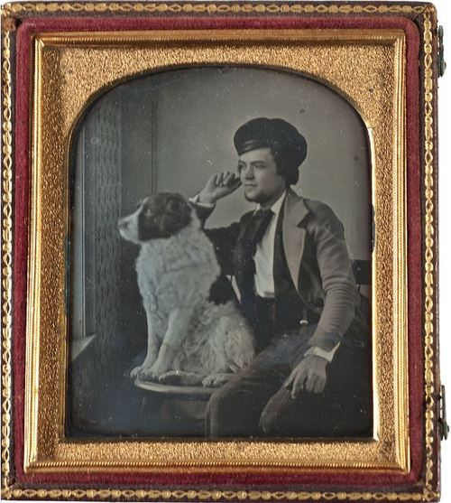 Young man and his dog looking out a window, their gazes fixed on the same point. Either the dog showed remarkable discipline during the exposure to make this shot work, or the photographer used the old trick of releasing a caged bird at just the right time to freeze his movement. Circa 1850s. Courtesy of Cowan's Auctions, where the photo sold last year for over $4,000.